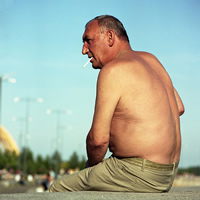 Image of older shirtless man